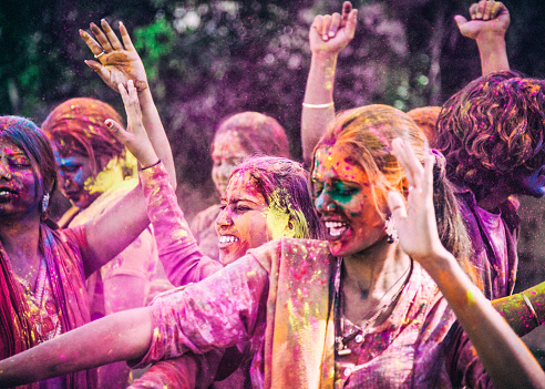 A group of young Indians hugging during the Holi Festival, in Jaipur India.